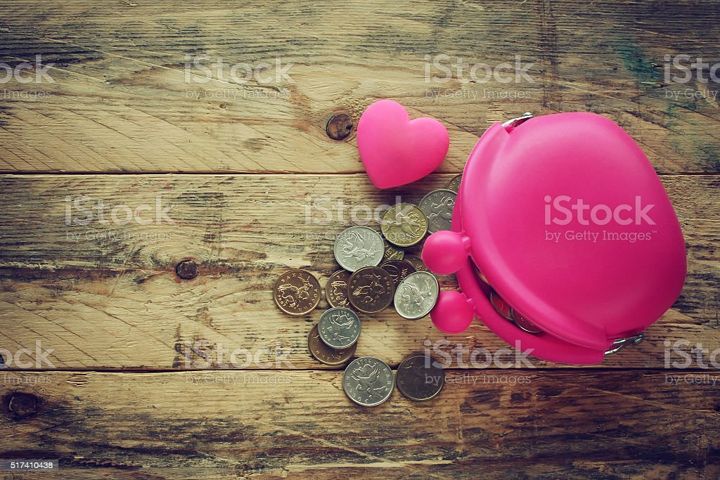 pink silicone purse with coins and heart stock photo