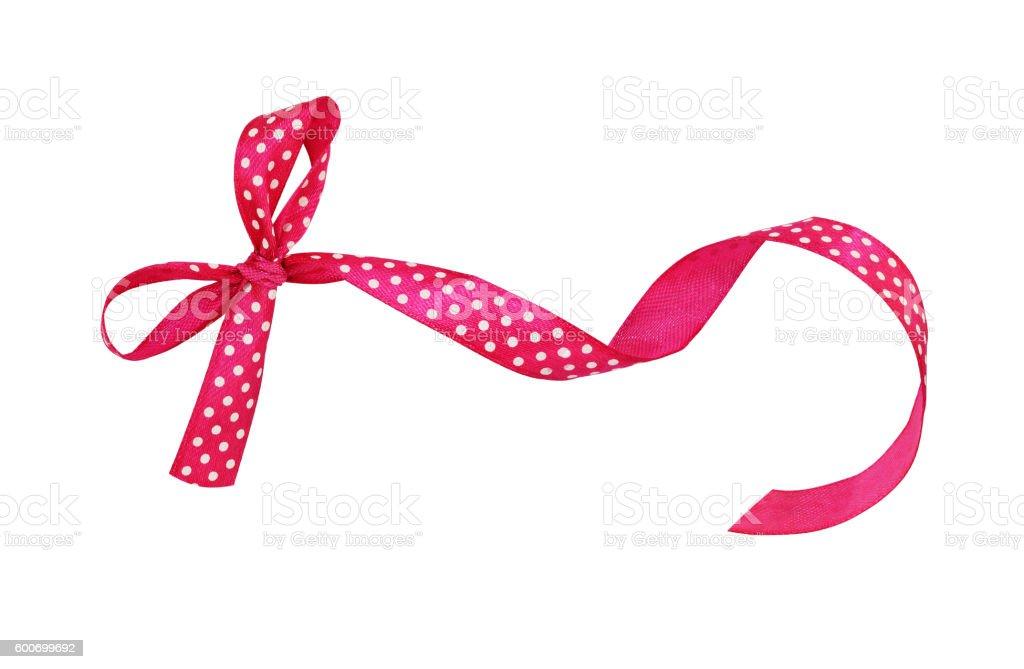 Pink silk polka dot ribbon bow stock photo