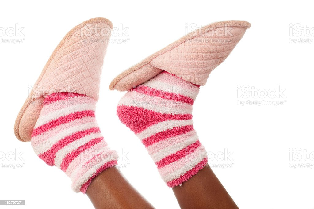 Pink slippers and colorful socks royalty-free stock photo