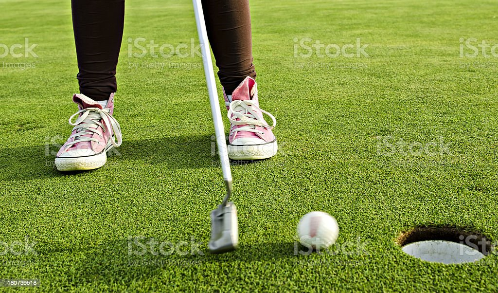 Pink sneakers Golfer teen goes in the hole royalty-free stock photo