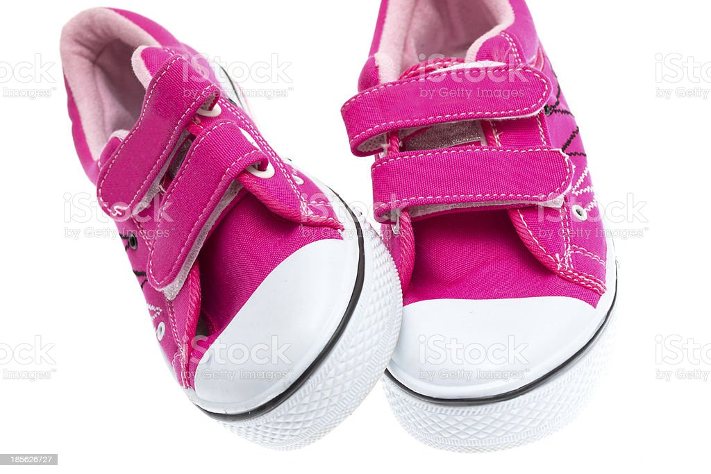 Pink sneakers isolated on white background royalty-free stock photo