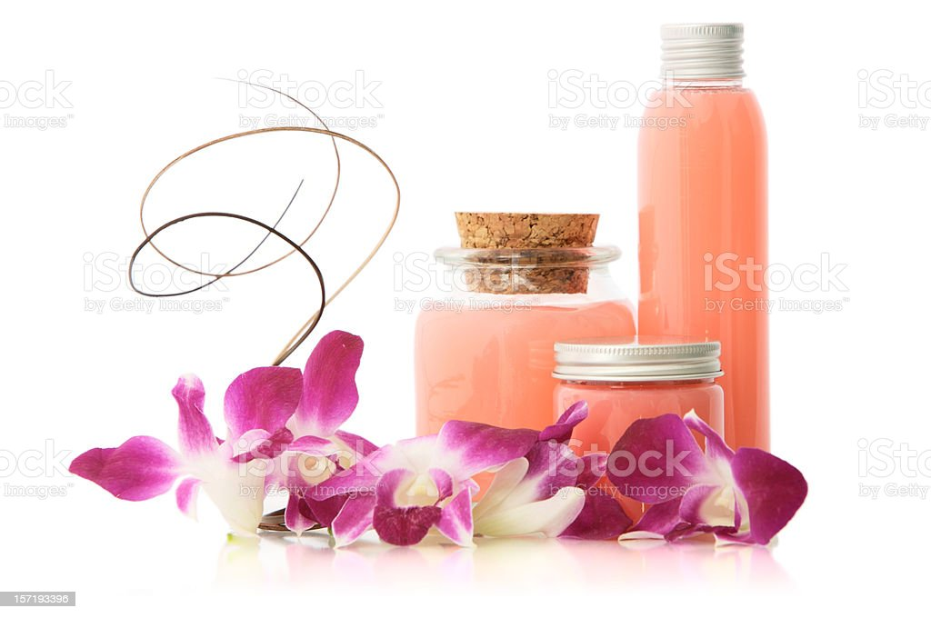 Pink soap bottles and flowers stock photo