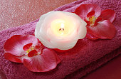pink Spa tools with candle and towel