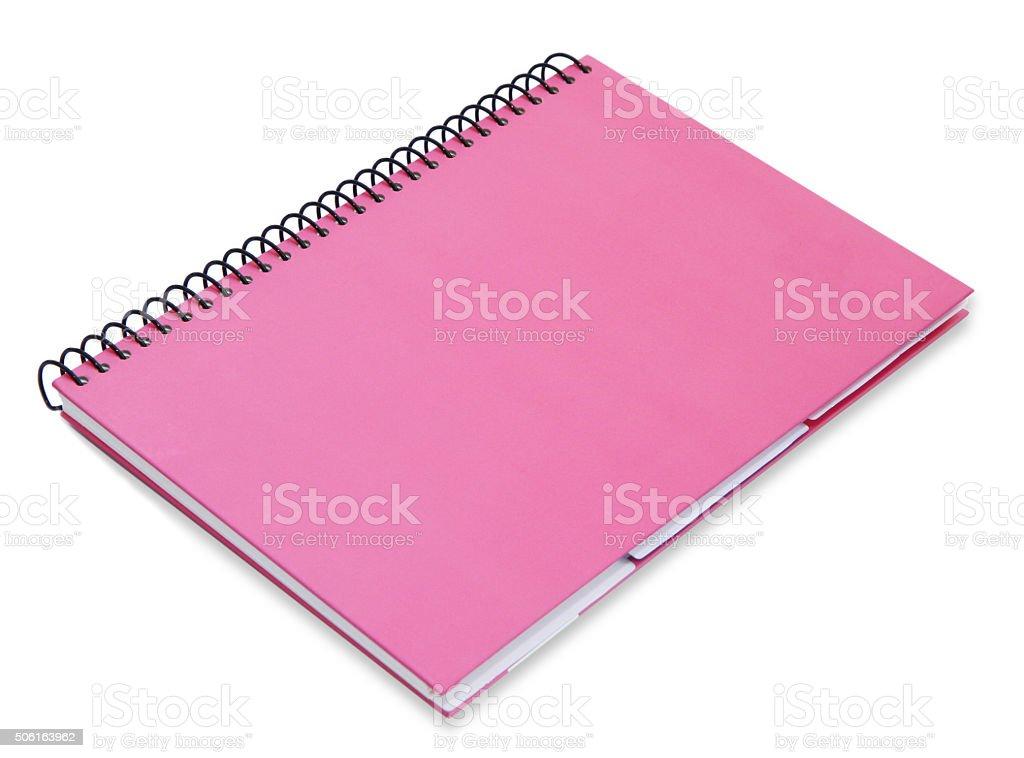 Pink spiral notebook stock photo