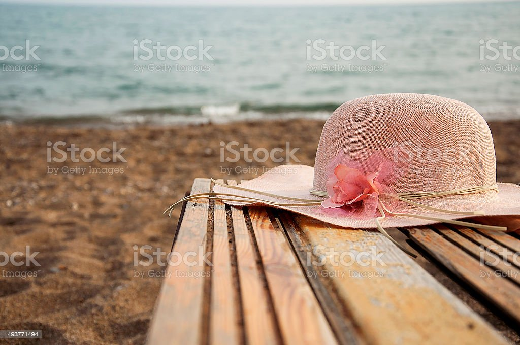 pink  straw hat and beach stock photo