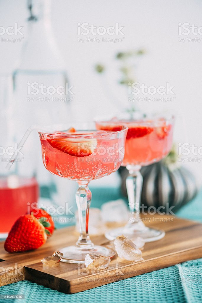 Pink summer cocktail drink with strawberries stock photo
