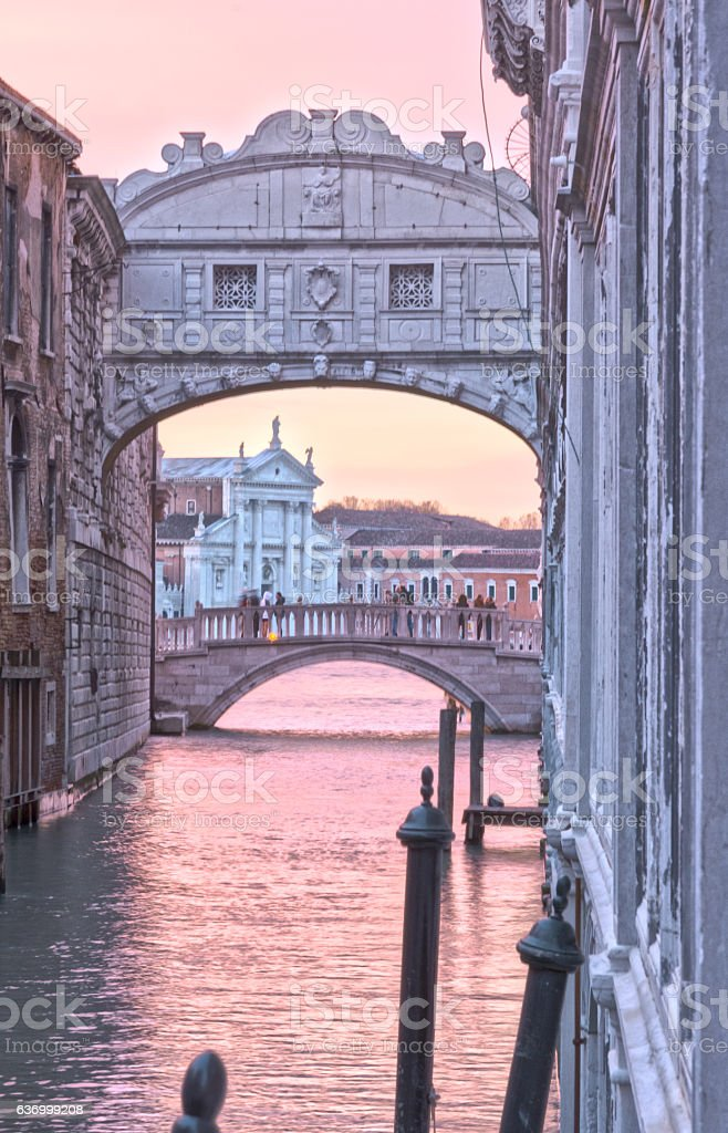 Pink sunrise at The Bridge of Sighs in winter Venice stock photo