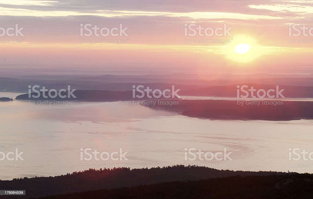 Pink sunrise in mountain and sea shore stock photo