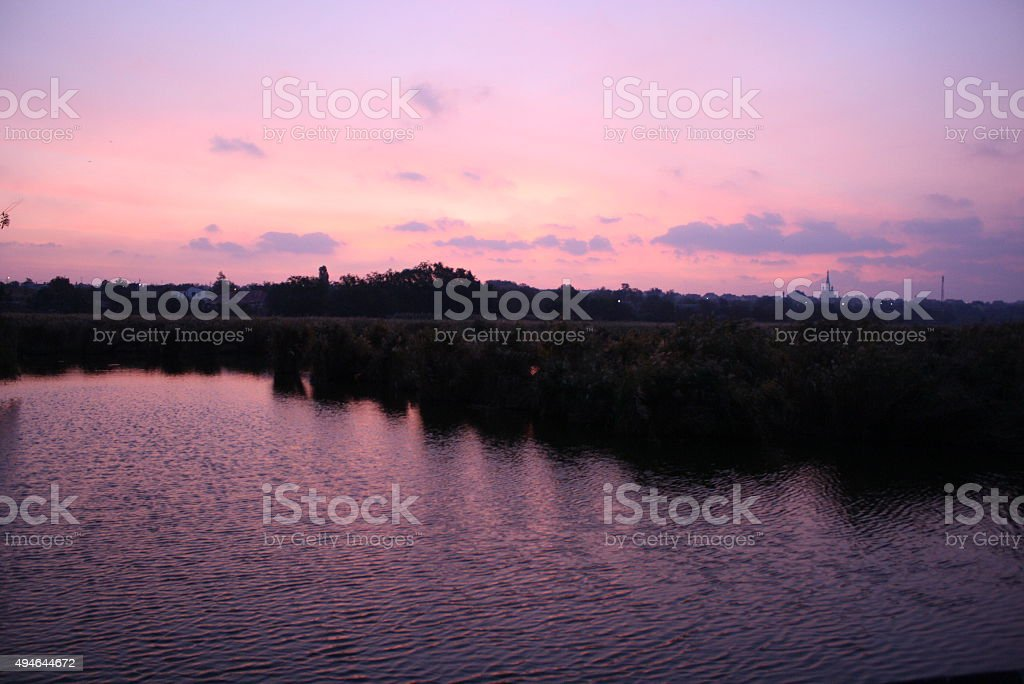 Pink sunrise on the bank of estuary smooth royalty-free stock photo