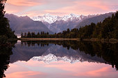 Pink sunrise over Lake Matheson, South Island, New Zealand