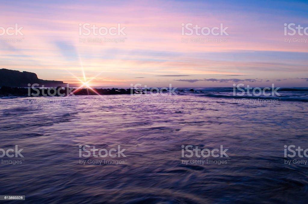 Pink sunrise with flare stock photo