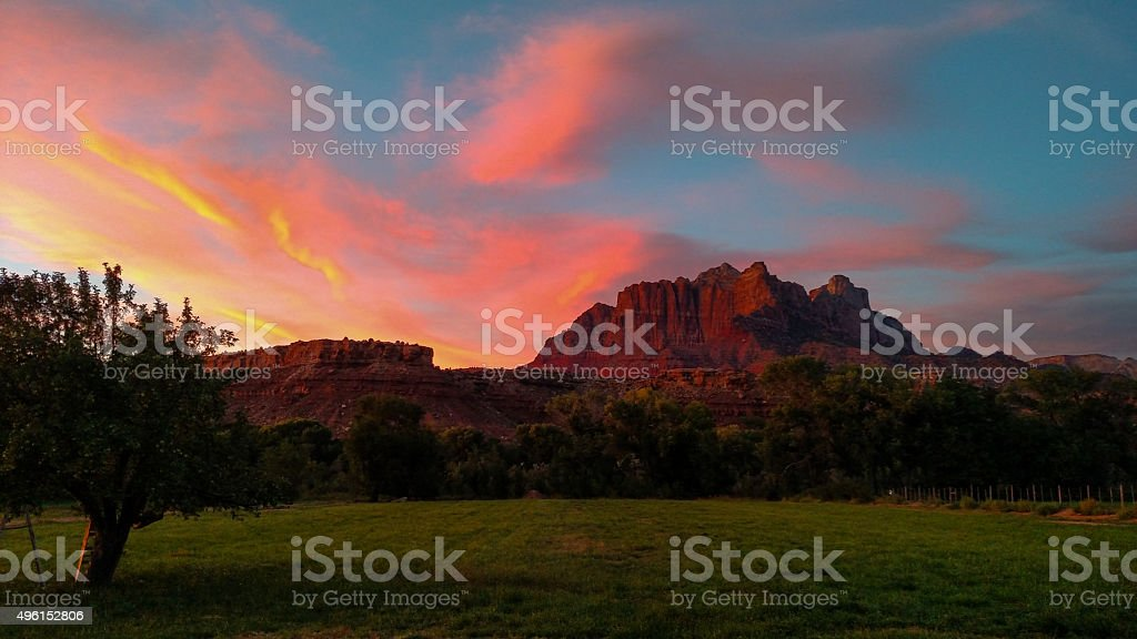 pink sunset clouds silhouette Mount Kinesava Zion National Park Utah stock photo