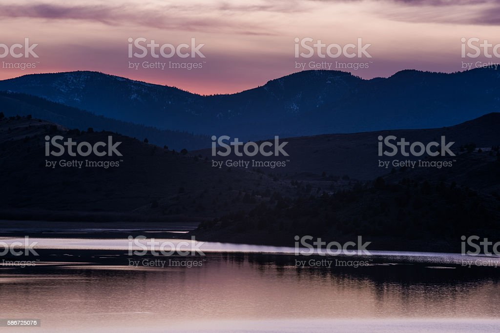Pink sunset in Weed California lake by Mount Shasta stock photo