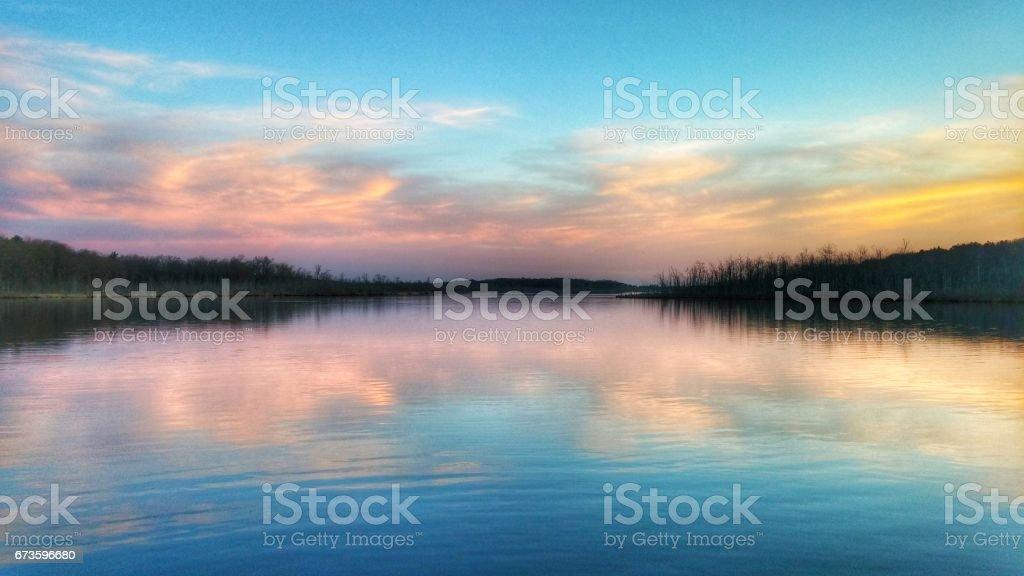 Pink Sunset Reflection, Tree Lined Saratoga Lake, New York stock photo