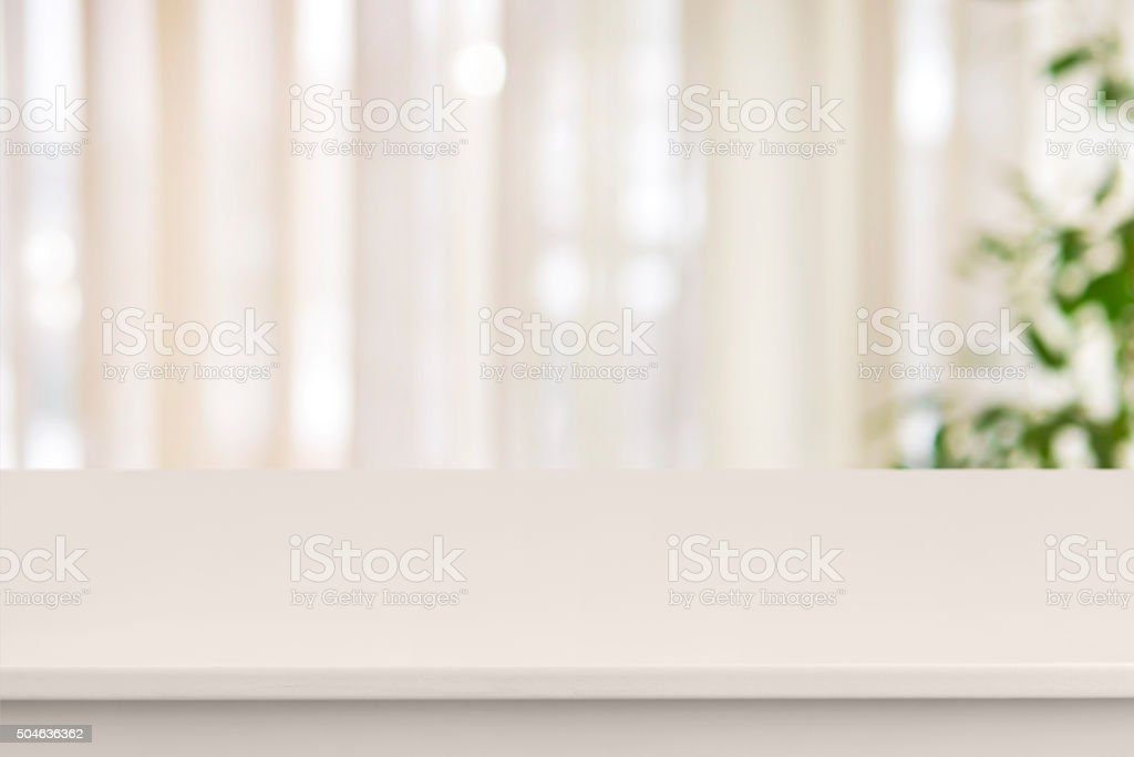 Pink table on defocuced window with curtain background stock photo