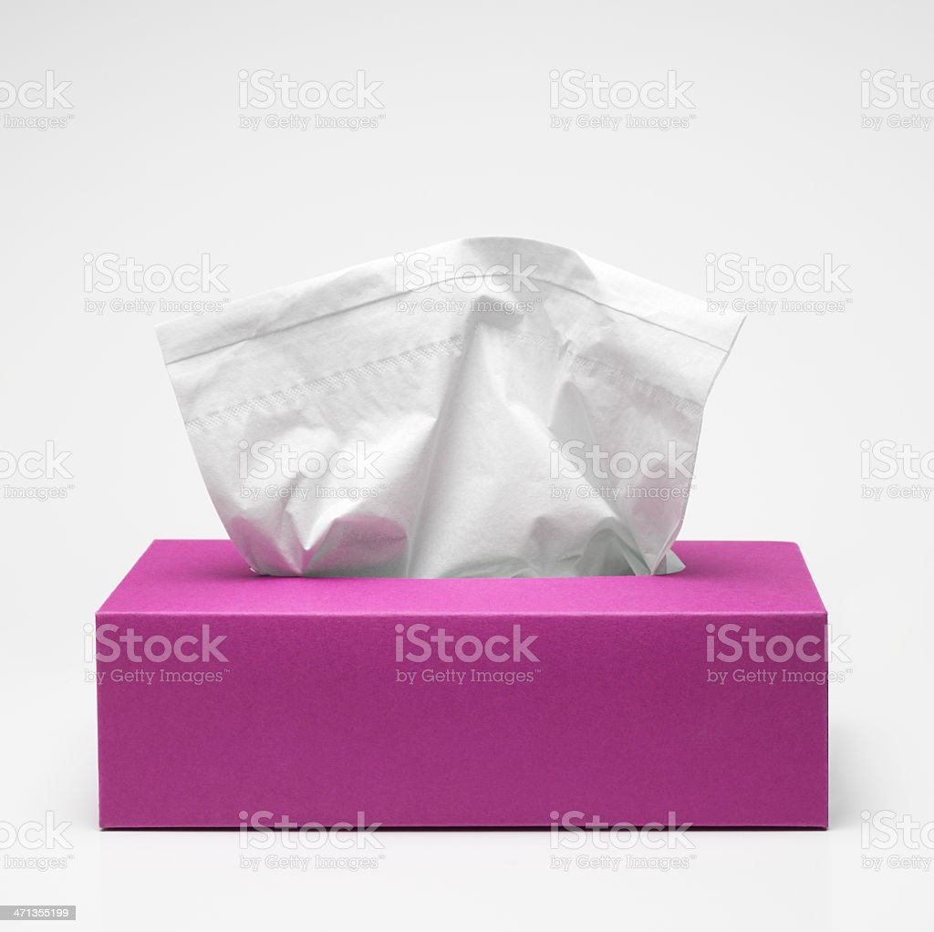 Pink tissue box with white tissues stock photo