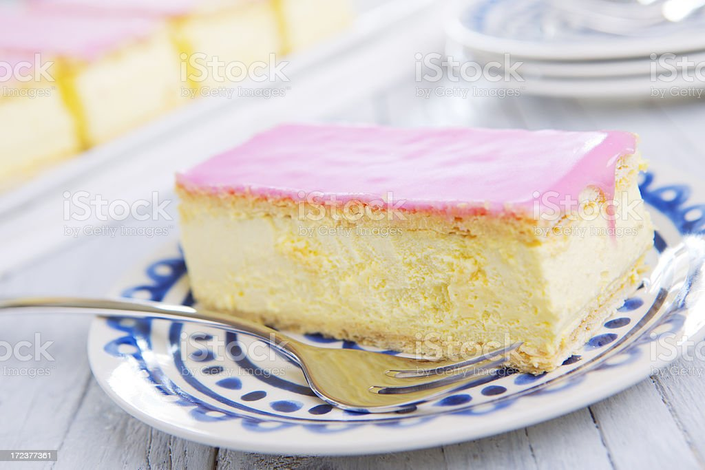 Pink tompouce, traditional Dutch pastry, on a rustic table royalty-free stock photo