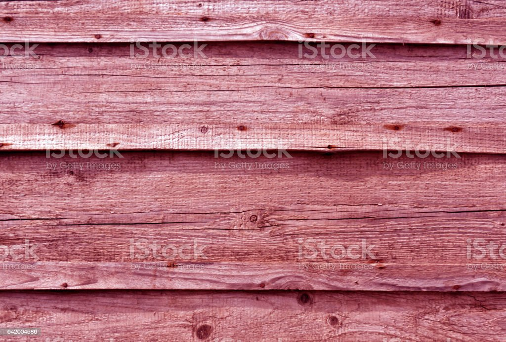 Pink toned wooden wall surface stock photo