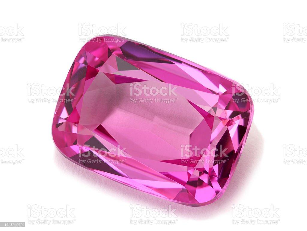Pink tourmaline gemstone isolated on a white background stock photo