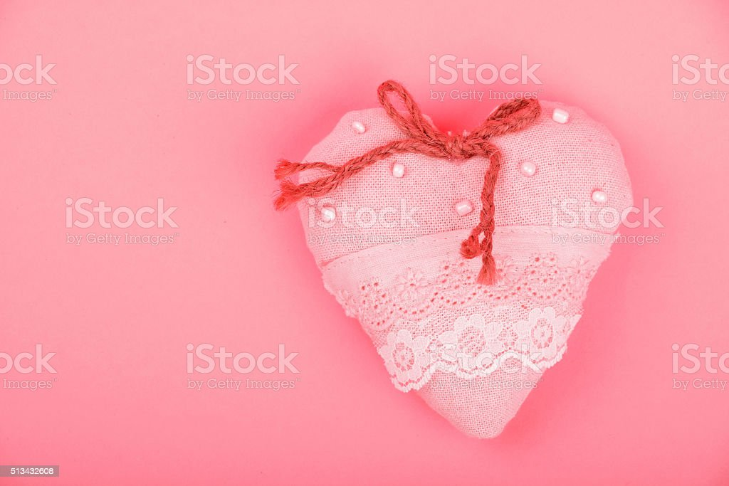 Pink toy textile lace heart with bow with copy space royalty-free stock photo