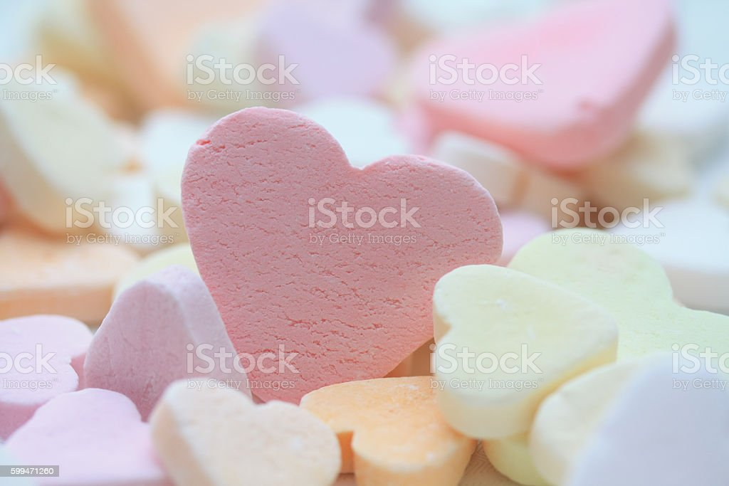 pink valentine candy heart stock photo