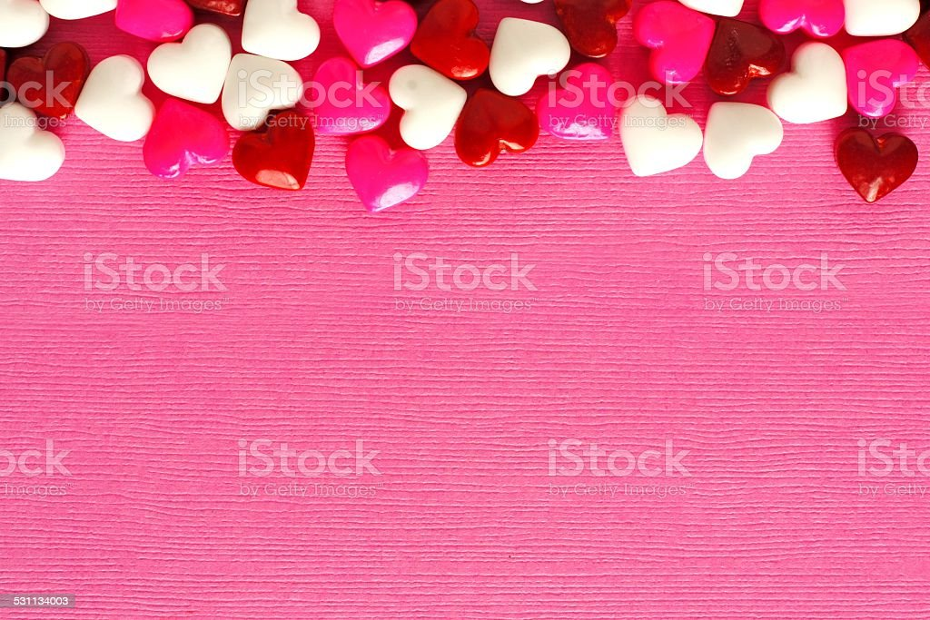 Pink Valentines Day background with candy border stock photo