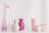 pink vases on white shelf