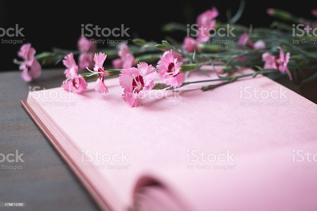 Pink vintage photo album page with flowers stock photo