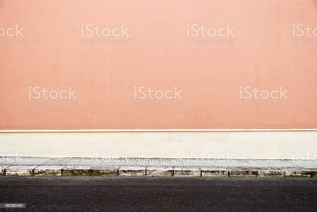 Pink wall with sidewalk royalty-free stock photo