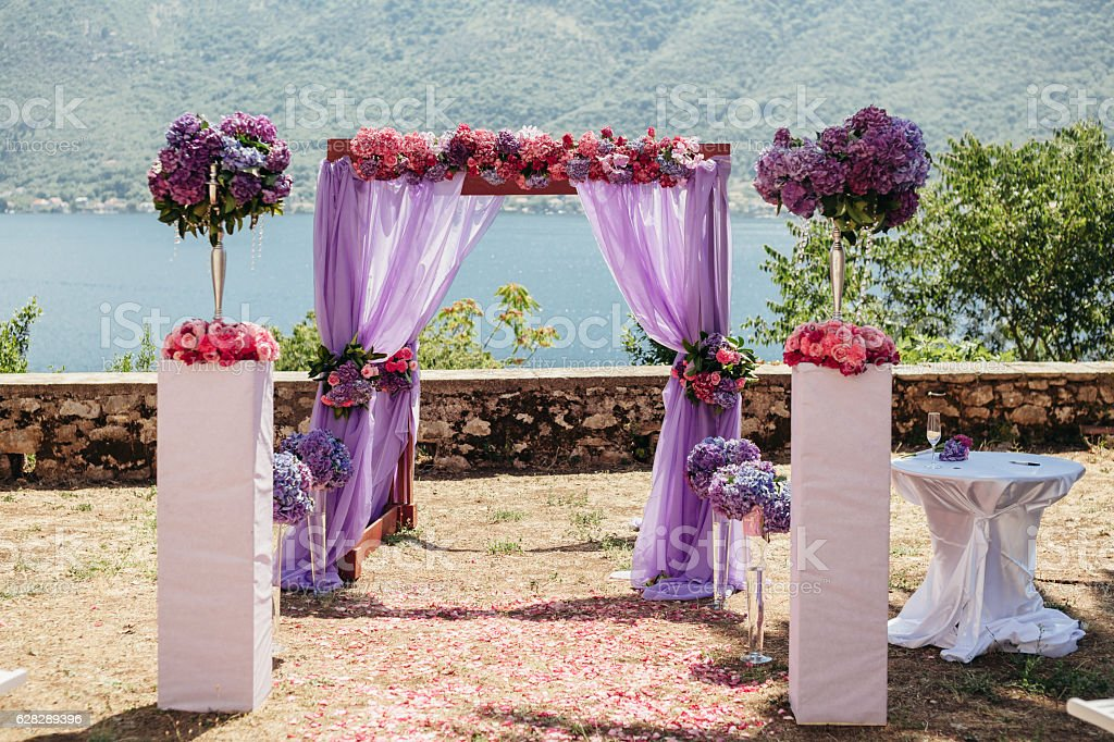 pink wedding arch with flowers stock photo