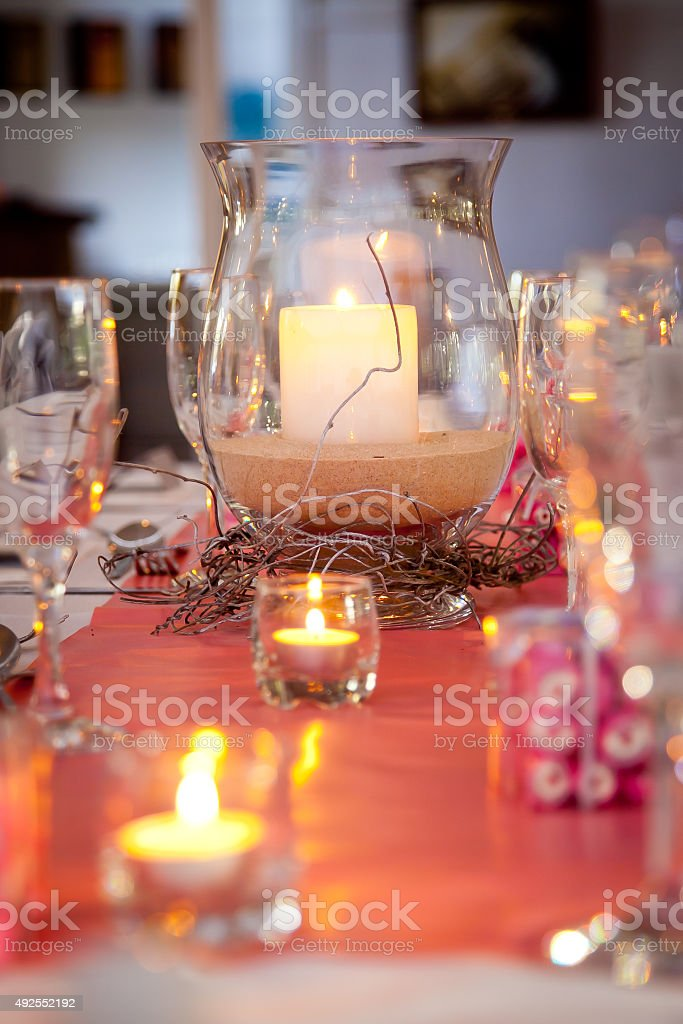 Pink Wedding Bridal Table with Sand and Candes stock photo