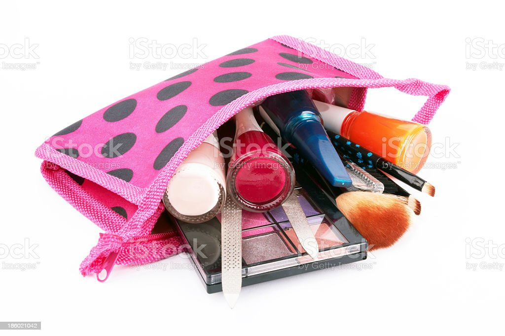 Pink with black polka dotted Cosmetic bag on its side stock photo