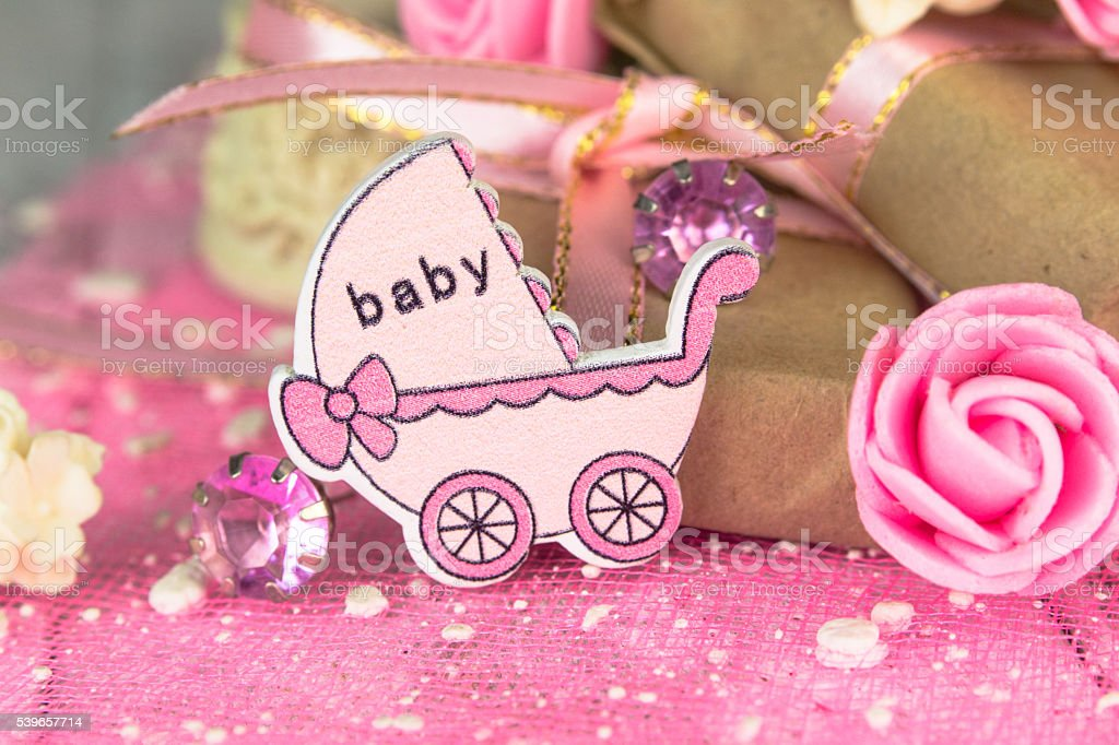 Pink wooden carriage figure with wrapped presents stock photo