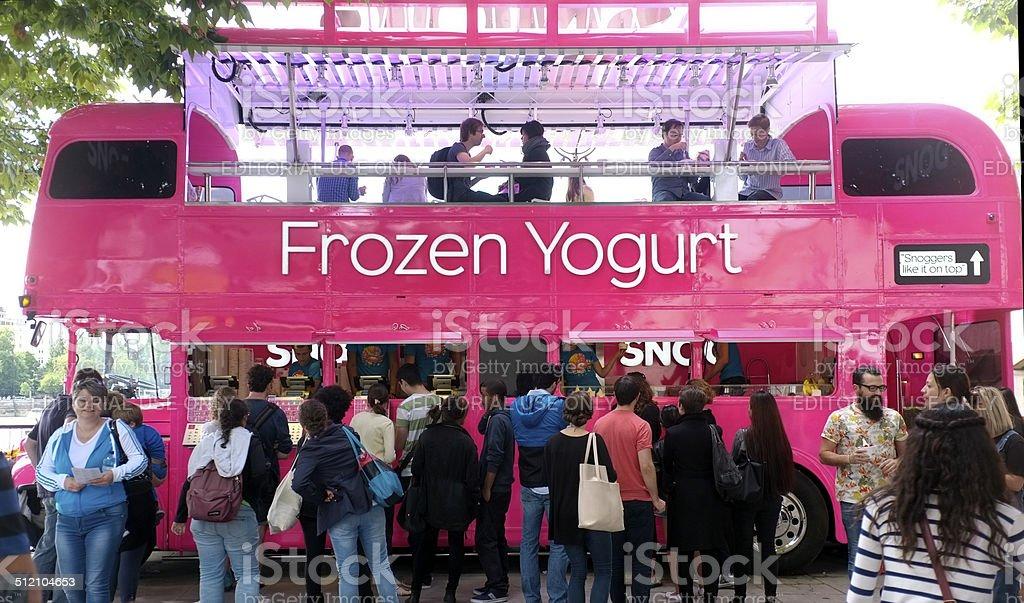 Pink yogurt London bus stock photo