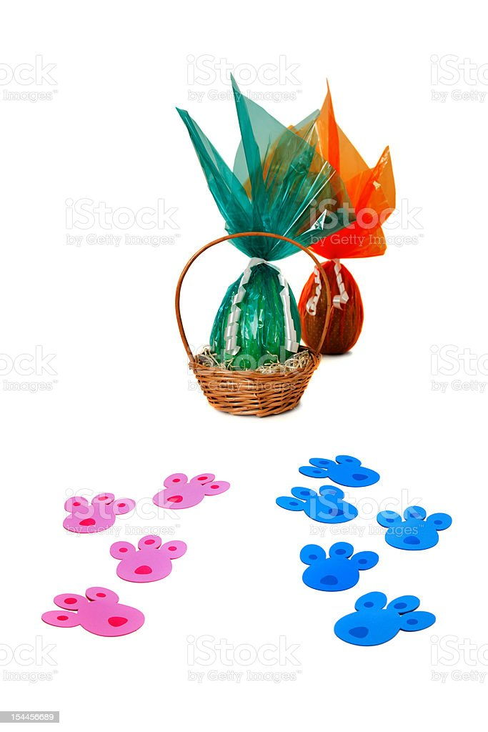 Pink/blue tracks and Easter basket royalty-free stock photo