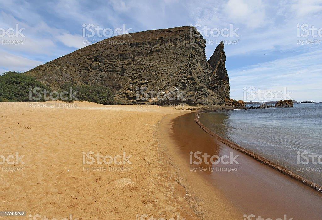 Pinnacle Rock viewed from the beach on Bartolome Island, Galapagos stock photo