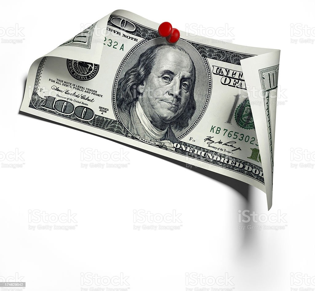 Pinned 100 dollar banknote on white wall royalty-free stock photo