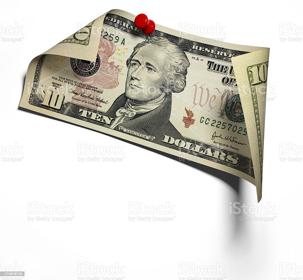 Pinned ten Dollar Banknote on white wall stock photo