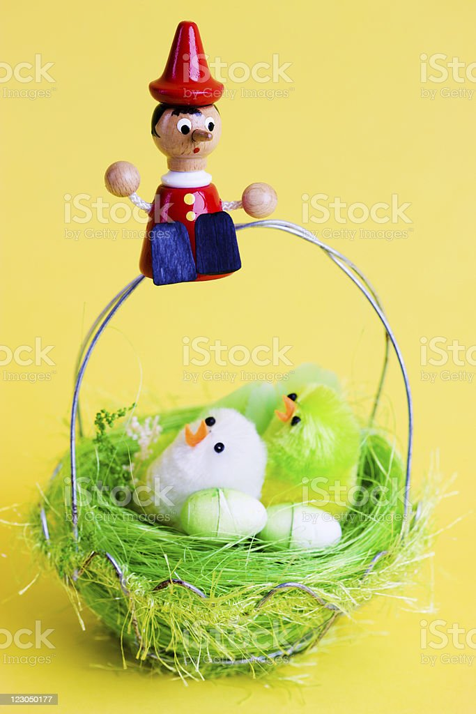 Pinocchio and Easter Basket royalty-free stock photo