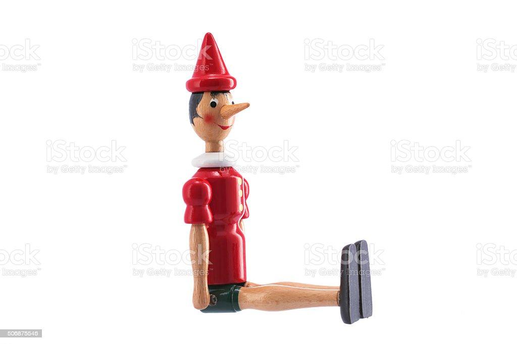 Pinocchio Toy Statue isolated on white stock photo