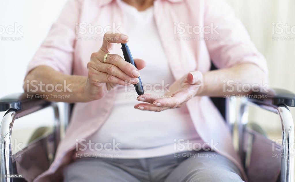 Pin-prick to the finger - Diabetes/Senior Health stock photo