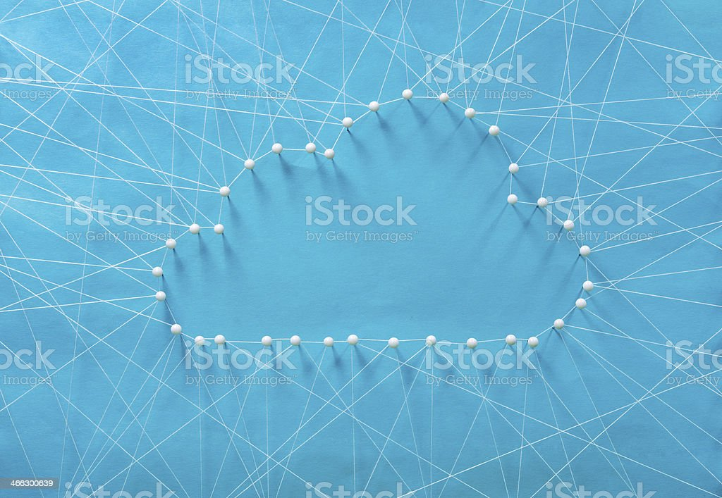 Pins and string form a cloud to reflect cloud computing stock photo
