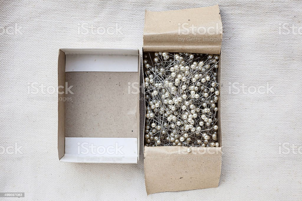 Pins in Paper box stock photo