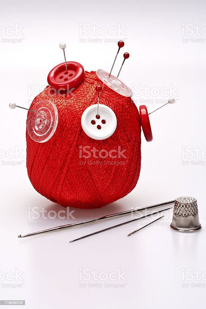 pins in wool ball with buttons royalty-free stock photo