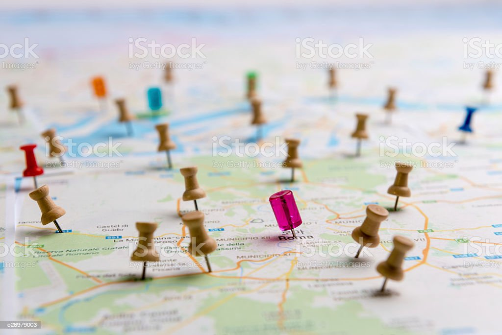 Pins marking location on map stock photo