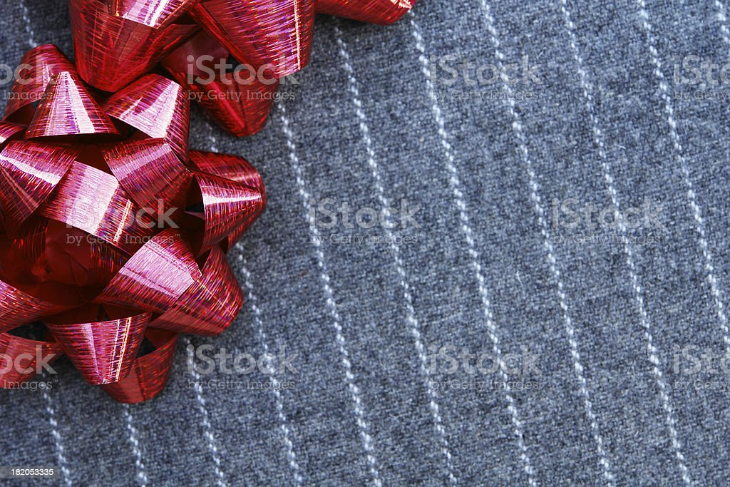 Pinstripe suit detail with red bows royalty-free stock photo