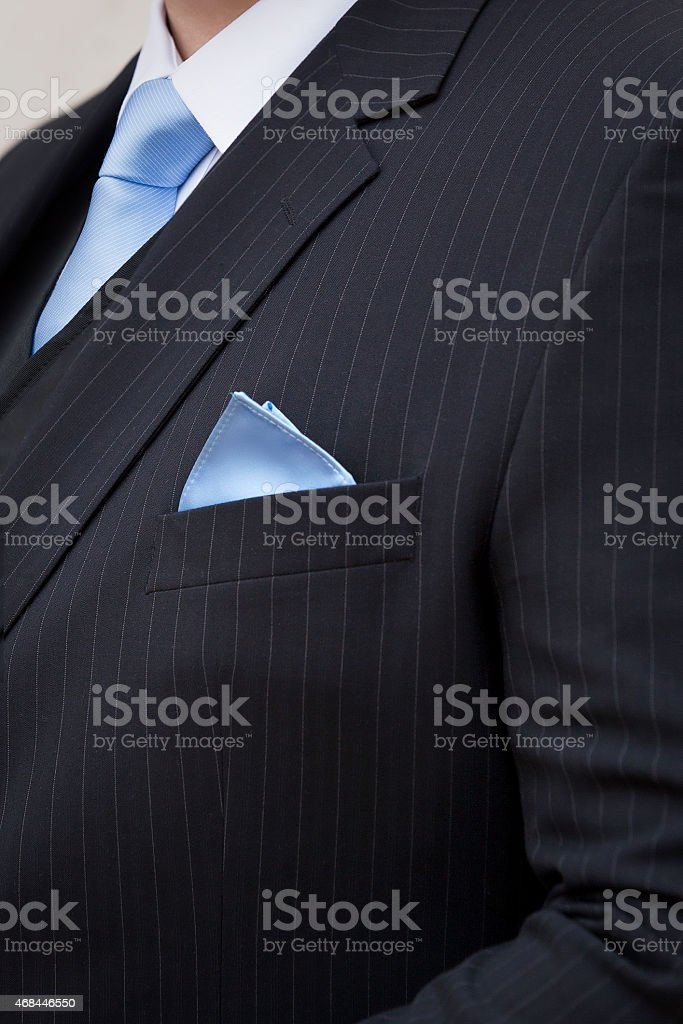 Pin-striped suit with blue tie and pocket handkerchief stock photo