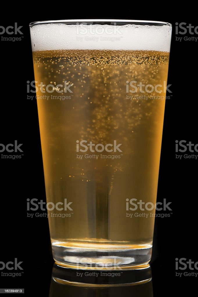 Pint Beer Glass on Black royalty-free stock photo