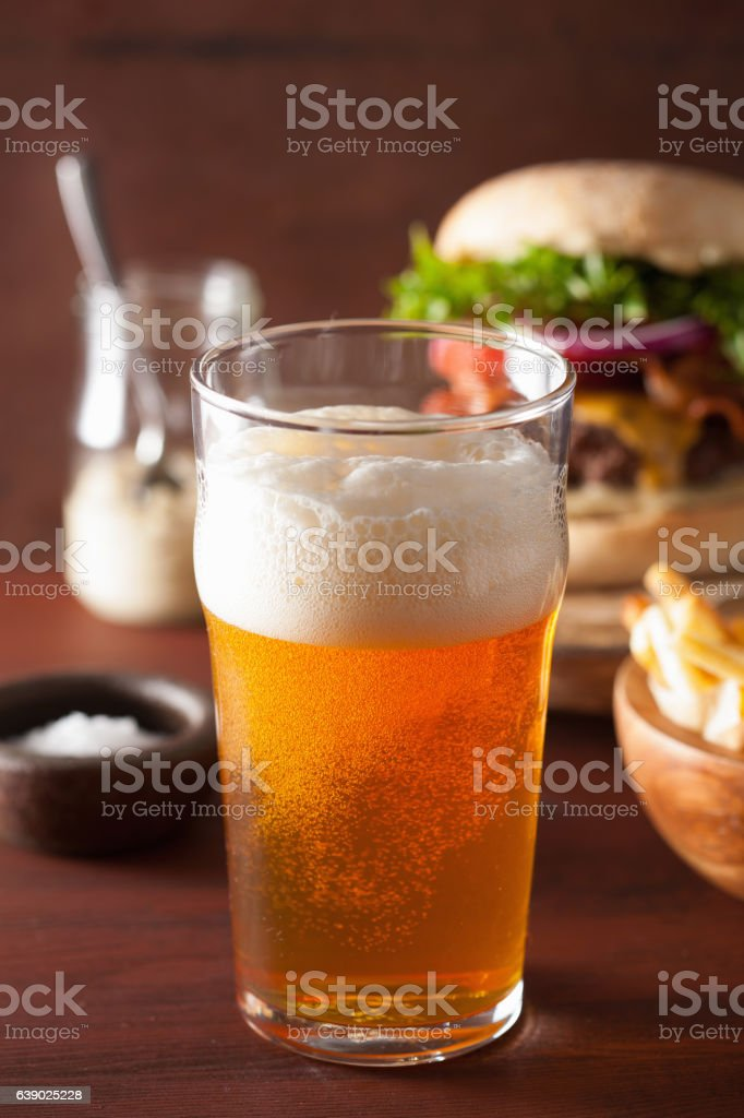 pint glass of india pale ale beer and fastfood stock photo