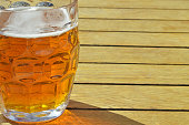 Pint of beer ale on wooden background